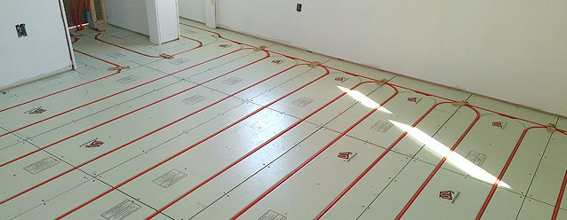 Radiant floor heat with an outdoor wood boiler for Best hydronic radiant floor heating systems
